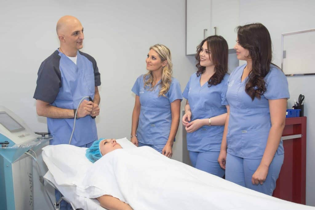 Dr. Nathan Newman and his medical staff prepare a patient for cosmetic surgery.
