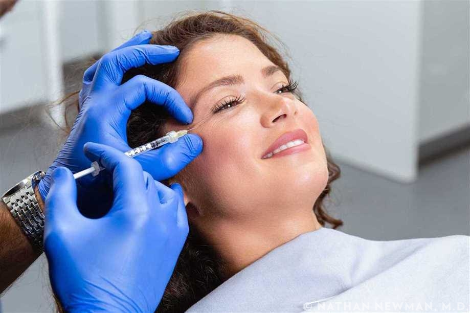Female patient getting Botox to the lateral eyes