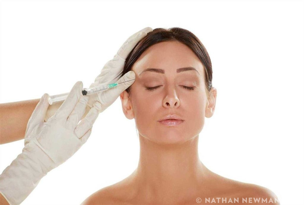Female patient getting Botox near her eyes