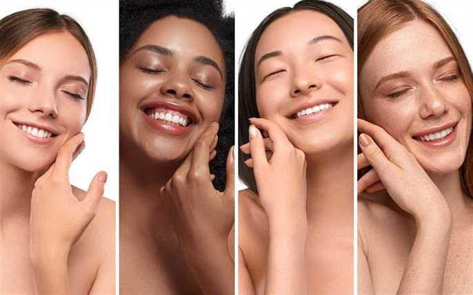 Four Women With Different Skin Types Feeling Their Faces